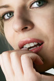 Model biting her fingernail Royalty Free Stock Photo