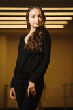 Model in black clothes elegant posing in frame stock images