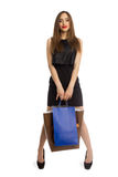 Model in black dress holding bags Stock Photography