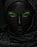 Model with black face. Royalty Free Stock Photo