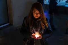 Model with black jacket in night photo with candles stock photography