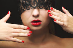 Model with black lace mask. Beautiful model with black lace mask, red lips and manicure stock photos