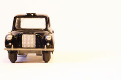 Model of black London taxi, front face Royalty Free Stock Image