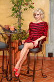 Model with black and red striped Bat wing sweater dress Royalty Free Stock Images