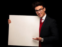 Model in black suit and glasses, presenting Royalty Free Stock Photography
