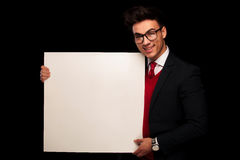 Model in black suit wearing glasses while presenting Stock Images