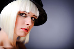 Model with blonde hair and black peaked cap Stock Image