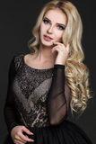 Model with blonde hair wearing dress with pattern. royalty free stock image