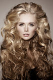 Model with blonde long hair. Waves Curls Hairstyle. Hair Salon. stock images