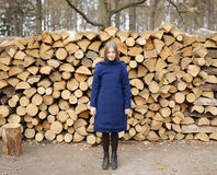 Model in a blue coat against wooden materials Royalty Free Stock Image