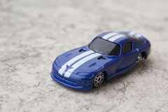 Model of blue sports car. Toys: model of blue sports car Royalty Free Stock Images
