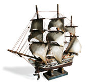 Model Boat. Old model of a sail boat in a white background stock photography