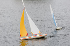 Model boat 2. Radio controlled model sailboat on lake with a good wind in a race Stock Images