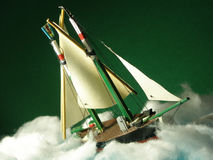 Model boat suffering bad weather. Model boat in the storm stock photos