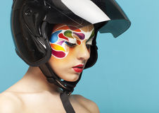 Model with bright creative make up with helmet Royalty Free Stock Images