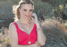 Model with bright dress outdoors. Beautiful stock photography