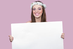 Model with bright flowers holding a blank poster Stock Photography