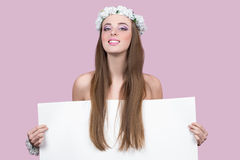 Model with bright flowers holding a blank poster Royalty Free Stock Photos