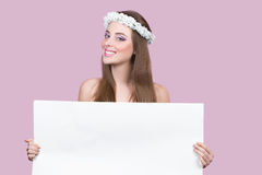 Model with bright flowers holding a blank poster Royalty Free Stock Photography