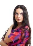 Model brunette longhair girl isolated in red Stock Images