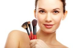 Model with brushes Stock Images