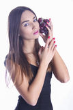 Model with bunch of grapes Royalty Free Stock Photos