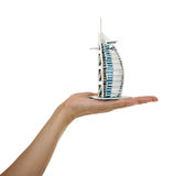 Model Burj al Arab in the women's hand. Royalty Free Stock Images