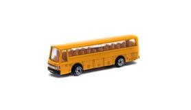Model bus. Yellow toy model bus on white background Stock Photos