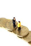 Model business figures coins B Stock Image