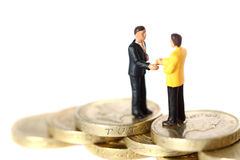 Model business figures coins C Royalty Free Stock Photos