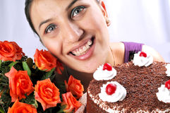 Model with cake and flowers Stock Image