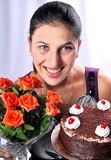 Model with cake and flowers Royalty Free Stock Photo