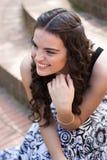 Model candid shot. Candid shot of brunette model smiling long hair royalty free stock photo