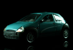 Model Car. A model car with a reflection on a mirror, against a black background Stock Image