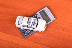Model car on a calculator Stock Photos