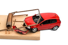 Model car in a mousetrap. A model car in a mousetrap, symbolic photo for car expenses and liabilities Royalty Free Stock Photos
