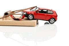 Model car in a mousetrap. A model car in a mousetrap, symbolic photo for car expenses and liabilities Royalty Free Stock Image