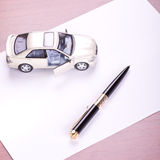 Model of the car and pen on paper Royalty Free Stock Photos