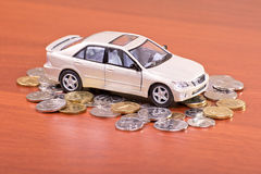 Model car on a placer of coins Stock Photo
