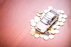Model car on a placer of coins Stock Image