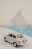 Model car (toy) on the road overlooking the ship Stock Image