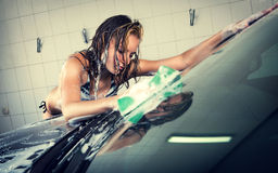 Model at the car wash in garage Royalty Free Stock Photos