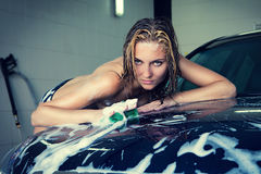 Model at the car wash in garage Stock Photo