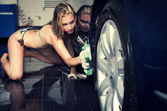 Model at the car wash in garage. Royalty Free Stock Photography