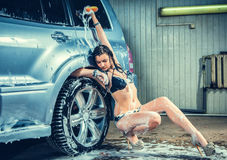 Model at the car wash in garage Stock Photography