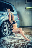 Model at the car wash in garage Stock Image