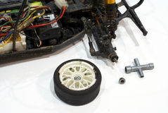Model car wheel. Fixing a model car with broken weel Stock Photo