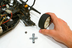 Model car wheel. Fixing a model car with broken weel Stock Images