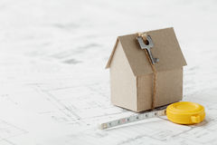 Free Model Cardboard House With Key And Tape Measure On Blueprint. Home Building, Architectural And Construction Design Concept Stock Photo - 60199290