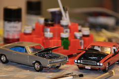 Model Cars. With paint, brushes in background Stock Photography